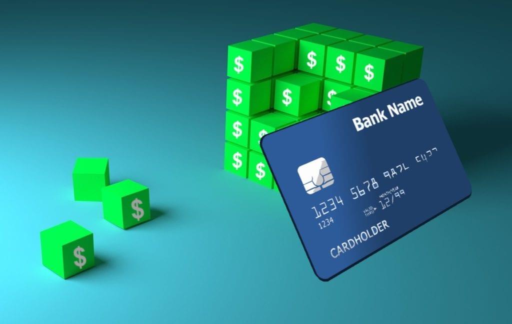 credit card next to green blocks